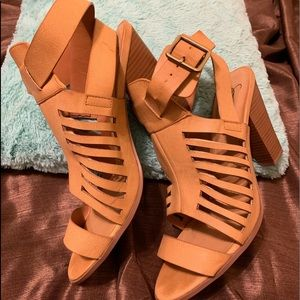 Tan strappy 3 inch heeled sandals.